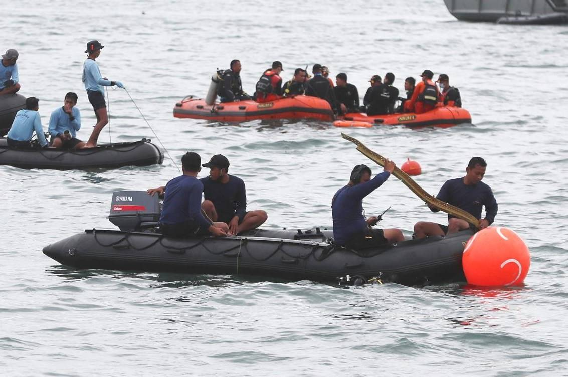 Rescuers carry debris found in the waters around the location where a Sriwijaya Air passenger jet has lost contact with air traffic controllers shortly after the takeoff, in Java Sea, near Jakarta, Indonesia, Sunday, Jan. 10, 2021. Indonesian divers on Sunday located parts of the wreckage of a Boeing 737-500 in the Java Sea, a day after the aircraft with dozens of people onboard crashed shortly after takeoff from Jakarta.(AP Photo/Achmad Ibrahim)