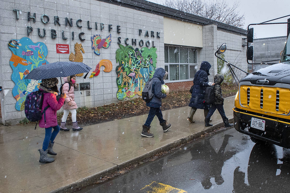 Students from another school board a bus outside Thorncliffe Park Public School in Toronto on Friday December 4, 2020. Toronto Public Health closed the school due to a COVID19 outbreak. THE CANADIAN PRESS/Frank Gunn