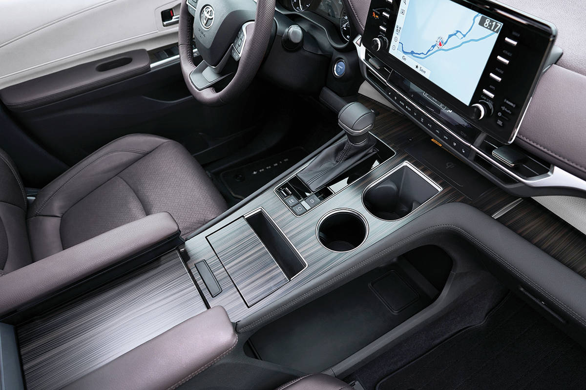 The Sienna has up to 18 cupholders although the two in the centre console might be the most important. The shift lever commands a continuously variable transmission. PHOTO: TOYOTA