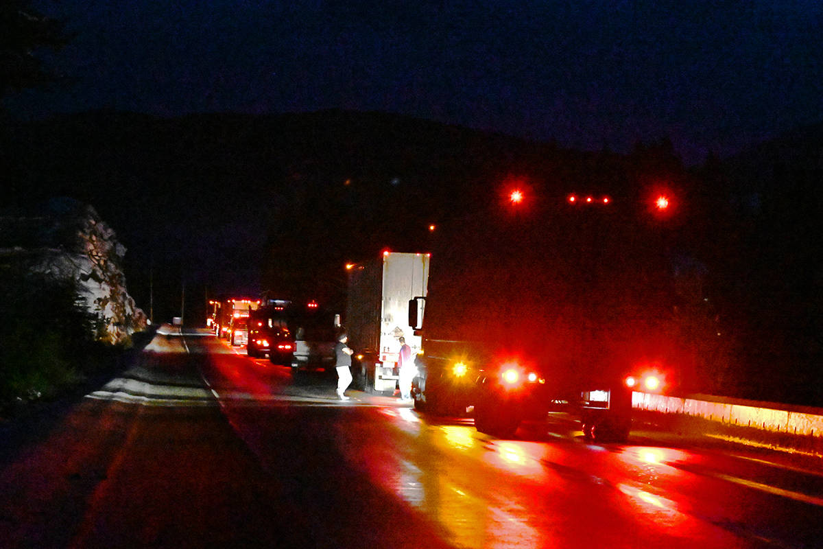 A couple of truck drivers were chatting while waiting for the traffic to start moving Sunday night after a head-on collision shut down Highway 5. The roads weren't cleared until late in the evening. (Stephanie Hagenaars photo)