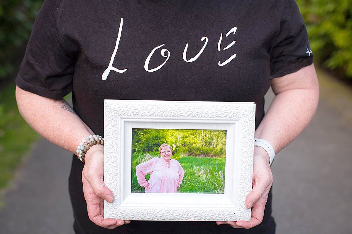 Langley's Morgan Green holds a picture of her mother, the woman who inspired a spreading kindness initiative called the Moe Moe Effect. (Special to Langley Advance Times)