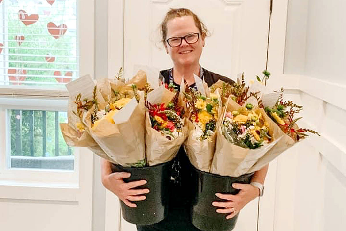 Morgan Green cashed in points, redeemed gift cards, and threw in some of her own money to buy flowers to randomly give away, all as part of the Moe Moe Effect. (Special to Langley Advance Times)