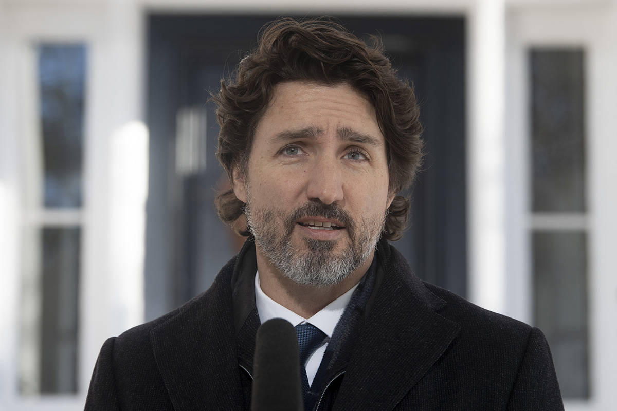 Prime Minister Justin Trudeau delivers his opening remarks during a news conference outside Rideau cottage in Ottawa, Friday, January 8, 2021. THE CANADIAN PRESS/Adrian Wyld