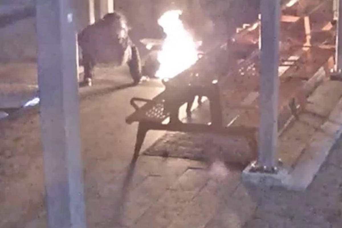 Police released surveillance footage of a man setting fire to a homeless woman's blankets while she slept on a downtown sidewalk on Hamilton Street, near the Queen Elizabeth Theatre, around 4 a.m. on Dec. 13, 2020. (Vancouver police handout)