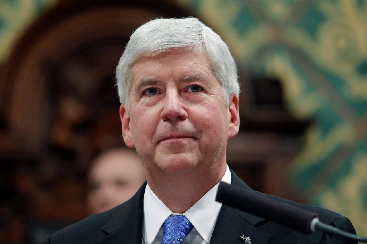 FILE - In this Jan. 23, 2018, file photo, former Michigan Gov. Rick Snyder delivers his State of the State address at the state Capitol in Lansing, Mich. Former Gov. Snyder, Nick Lyon, former director of the Michigan Department of Health and Human Services, and other ex-officials have been told they're being charged after a new investigation of the Flint water scandal, which devastated the majority Black city with lead-contaminated water and was blamed for a deadly outbreak of Legionnaires' disease in 2014-15, The Associated Press has learned. (AP Photo/Al Goldis, File)