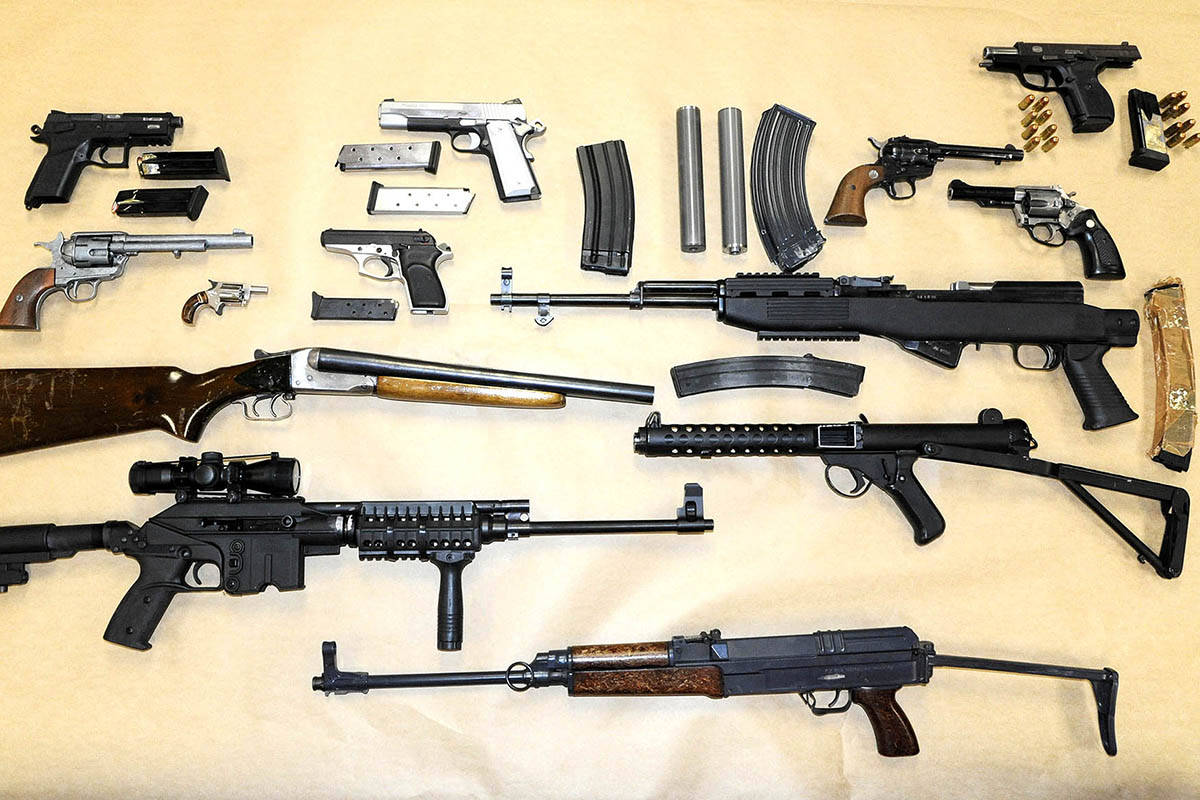 This picture shows the large stash of firearms, magazines, silencers and ammunition seized by police as part of an investigation that resulted in charges against Corey Perkins in December 2014. (Abbotsford Police Department photo)