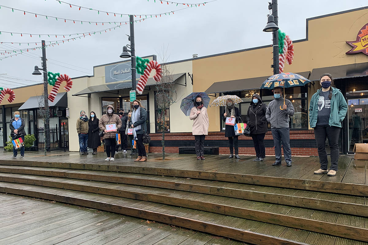 "Winners of the ""Shop Your Heart Out"" contest put on by the Downtown Langley Business Association posed for a group photo in McBurney Plaza on Tuesday, Jan. 12 (Special to Langley Advance Times)"