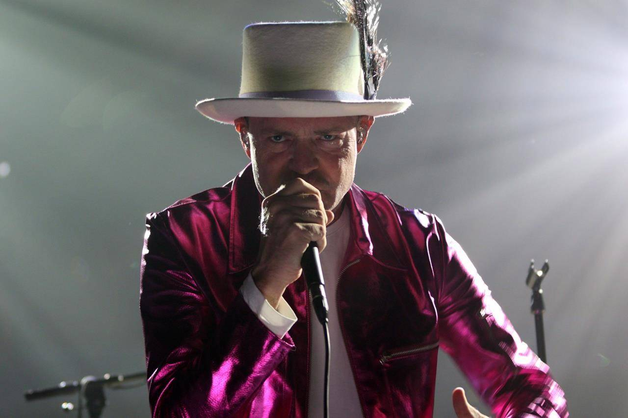 """The Tragically Hip's Gord Downie performs during the first stop of the Man Machine Poem Tour in Victoria, B.C., Friday, July 22, 2016. COVID-19 face masks emblazoned with the Tragically Hip's popular song title """"Courage"""" have raised more than $40,000 for Canada's music industry. THE CANADIAN PRESS/Chad Hipolito"""