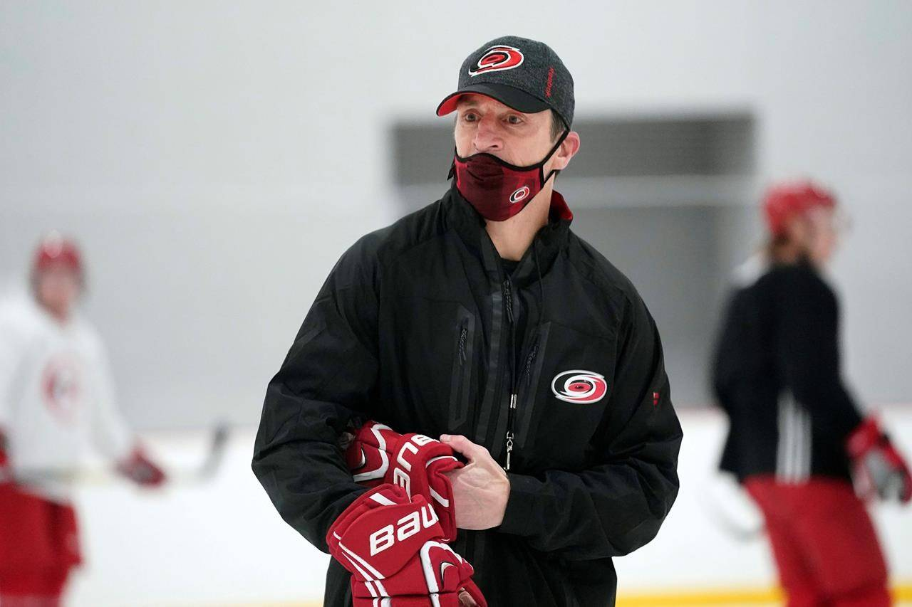 Carolina Hurricanes coach Rod Brind'Amour conducts drills during NHL hockey training camp in Morrisville, N.C., Wednesday, Jan. 6, 2021. (AP Photo/Gerry Broome)