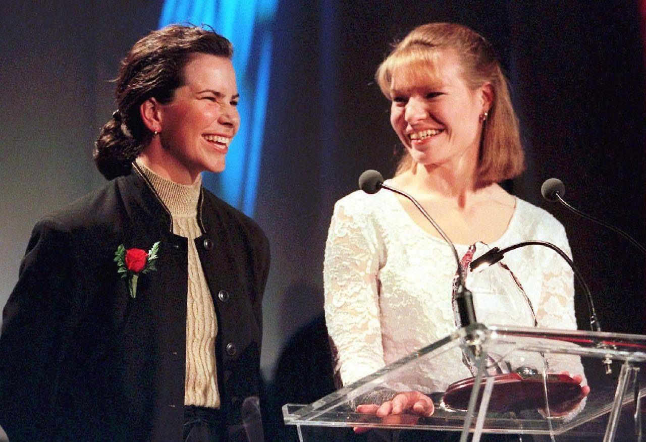 Kathleen Heddle, right, and Marnie McBean are all smiles after winning the award for outstanding pairs at the Canadian Sport Awards in Toronto on March 25, 1997. Olympic rowing champion Kathleen Heddle has died of cancer at age 55. Heddle, born in Trail, B.C., and Marnie McBean won Olympic gold medals in 1992 and 1996. Heddle also earned gold with the women's eight in 1992. Heddle died Monday at home in Vancouver, according to a Rowing Canada statement issued Wednesday on behalf of her family. THE CANADIAN PRESS/Kevin Frayer