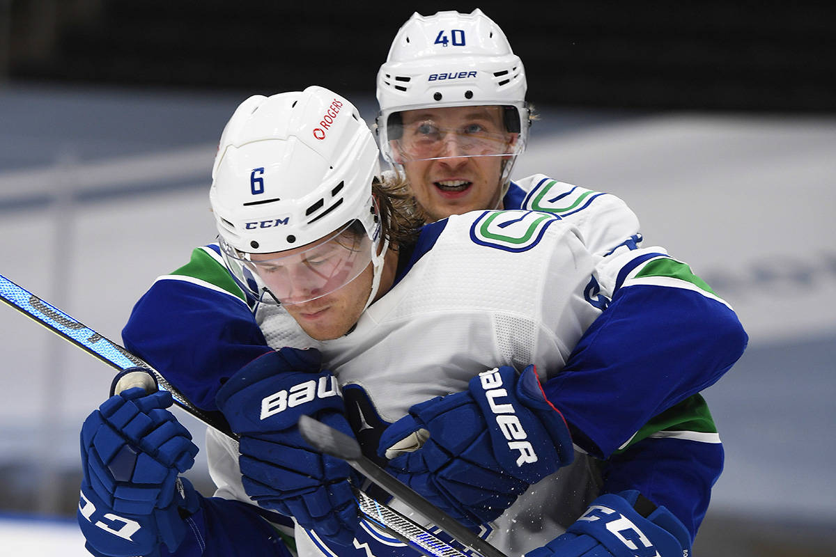 Vancouver Canucks' Brock Boeser (6) and Elias Pettersson (40) celebrate a goal against the Edmonton Oilers during third period NHL action in Edmonton on Wednesday, Jan. 13, 2021. THE CANADIAN PRESS/Dale MacMillan