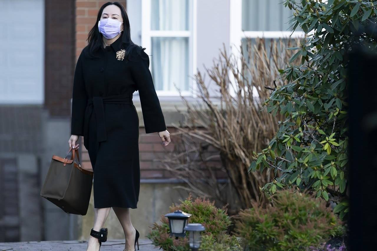 Chief financial officer of Huawei, Meng Wanzhou, leaves her home in Vancouver, Wednesday, January 13, 2021. Meng, who is free on bail while fighting extradition to the U.S., is seeking to have the terms of her release conditions changed.THE CANADIAN PRESS/Jonathan Hayward