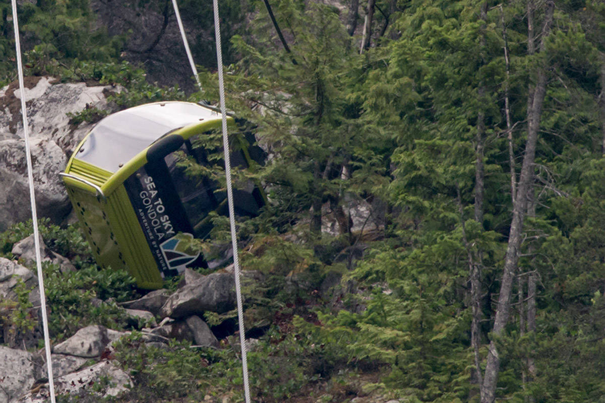 A gondola car rests on its side on the mountain after a cable snapped overnight at the Sea to Sky Gondola causing cable cars to crash to the ground below in Squamish, B.C., on Saturday, August 10, 2019. No injuries were reported and the gondola has been closed by operators for the foreseeable future. THE CANADIAN PRESS/Darryl Dyck