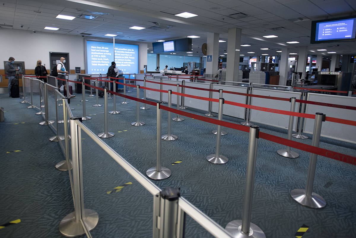Near empty security lines are seen at the domestic departures of Vancouver International Airport, Tuesday, June 9, 2020. Airlines in Canada and around the world are suffering financially due to the lack of travel and travel bans due to COVID-19. THE CANADIAN PRESS/Jonathan Hayward