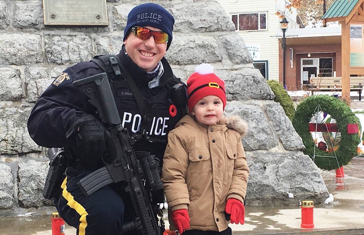 Constable Ken Jaques broke a window and crawled into a home to rescue an elderly man who had be laying on the floor for days. Jaques was the officer who provided oversight for the 2020 Remembrance Day services and is shown here in a picture with his son. Photo Andrea DeMeer
