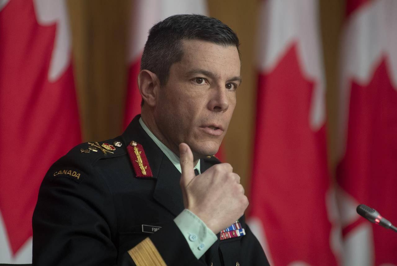 Maj.-Gen. Dany Fortin responds to a question on COVID vaccines during a news conference, Thursday, Jan. 14, 2021 in Ottawa. THE CANADIAN PRESS/Adrian Wyld