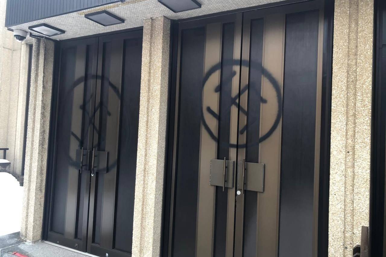 Spray-painted swastikas are shown on the doors of Shaar Hashomayim, one of Montreal's largest synagogues, in a handout photo. Montreal police say a 28-year-old man arrested Wednesday for allegedly defacing a synagogue with anti-Semitic graffiti will appear in court today. THE CANADIAN PRESS/HO