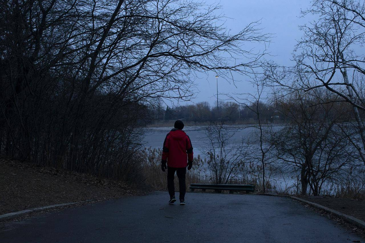 A passer by walks in High Park, in Toronto, Thursday, Jan. 14, 2021. This workweek will kick off with what's fabled to be the most depressing day of the year, during one of the darkest eras in recent history. THE CANADIAN PRESS/Chris Young