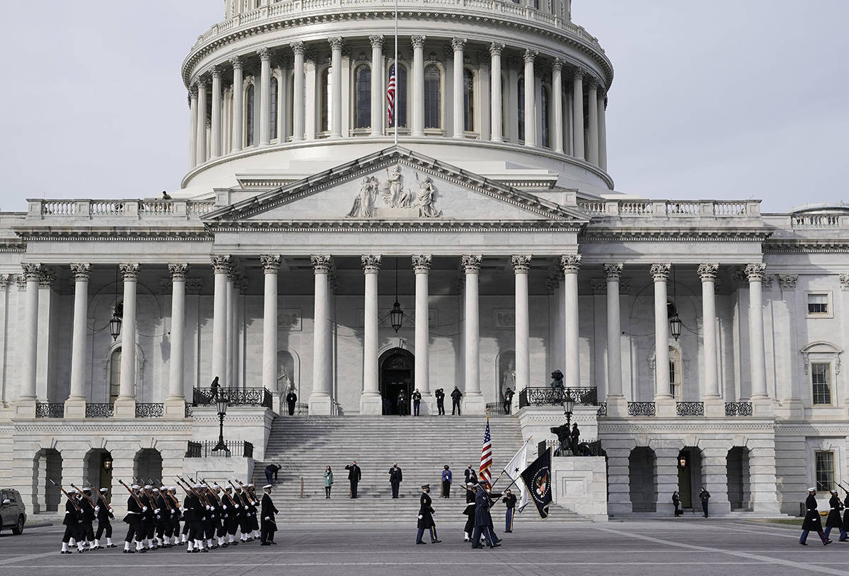 U.S. military units march in front of the Capitol, Monday, Jan. 18, 2021 in Washington, as they rehearse for President-elect Joe Biden's inauguration ceremony, which will be held at the Capitol on Wednesday. (AP Photo/J. Scott Applewhite)