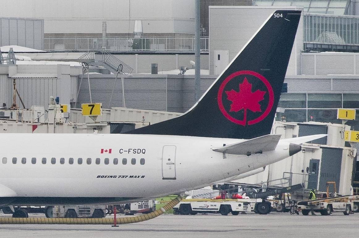 An Air Canada Boeing 737 Max 8 aircraft is shown next to a gate at Trudeau Airport in Montreal on March 13, 2019. Transport Canada has announced that it will allow the return of Boeing Max aircraft to service in Canadian airspace on Jan. 20, concluding the government's review process.THE CANADIAN PRESS/Graham Hughes
