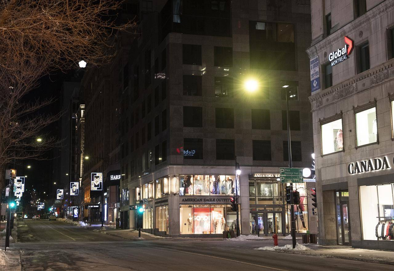 An empty Peel and Sainte-Catherine street is shown in Montreal, Saturday, Jan. 9, 2021, as the COVID-19 pandemic continues in Canada and around the world. THE CANADIAN PRESS/Graham Hughes