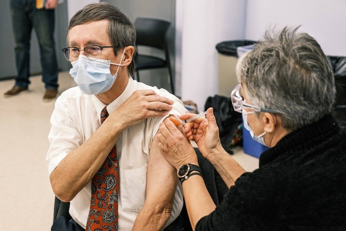 Island Health chief medical officer Dr. Richard Stanwick receives a first dose of Pfizer vaccine, Dec. 22, 2020. (B.C. government)