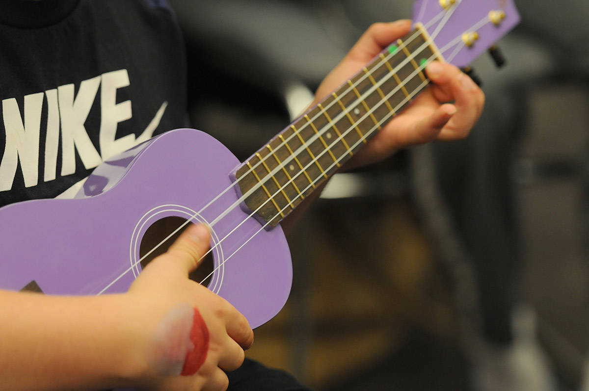 A child joins the Uke 'n Play kickoff event at the Chilliwack Library on Oct. 1, 2016. (Jenna Hauck/ Chilliwack Progress file)