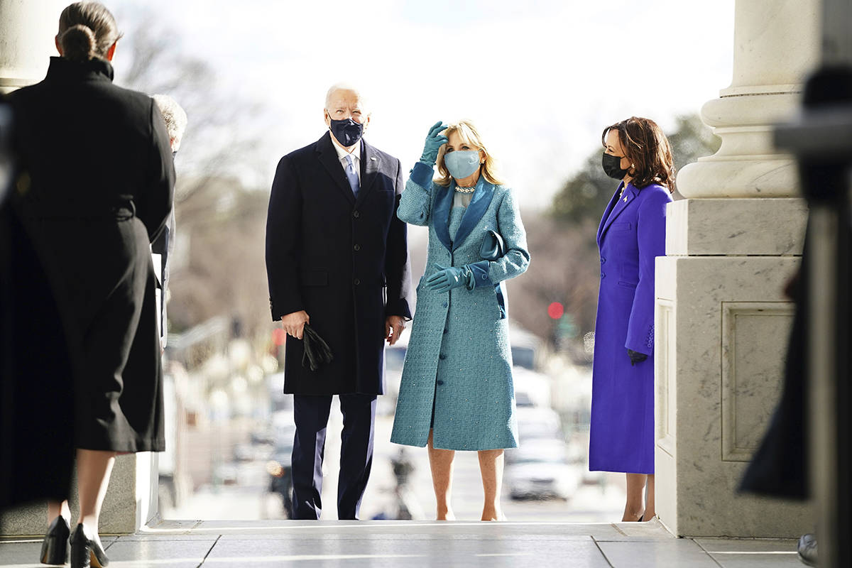 President-elect Joe Biden and his wife Jill Biden arrive at the East Front of the U.S. Capitol ahead of Biden's inauguration, Wednesday, Jan. 20, 2021, at the U.S. Capitol in Washington. (Jim Lo Scalzo/Pool Photo via AP)