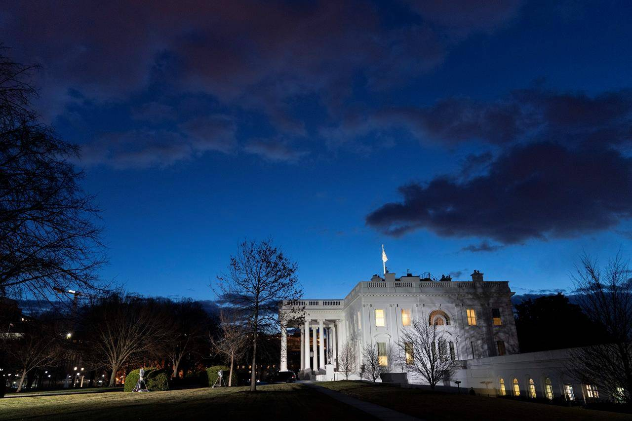 The sun rises behind the White House at dawn, Wednesday, Jan. 20, 2021, in Washington. (AP Photo/Alex Brandon)