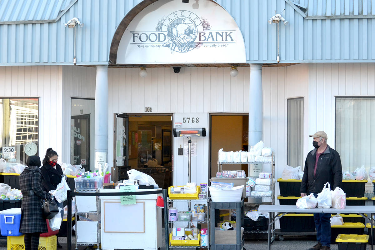 Volunteers at the Langley Food Bank have set-up distribution outside in the parking lot so clients can safely distance. (Ryan Uytdewilligen/Black Press Media)