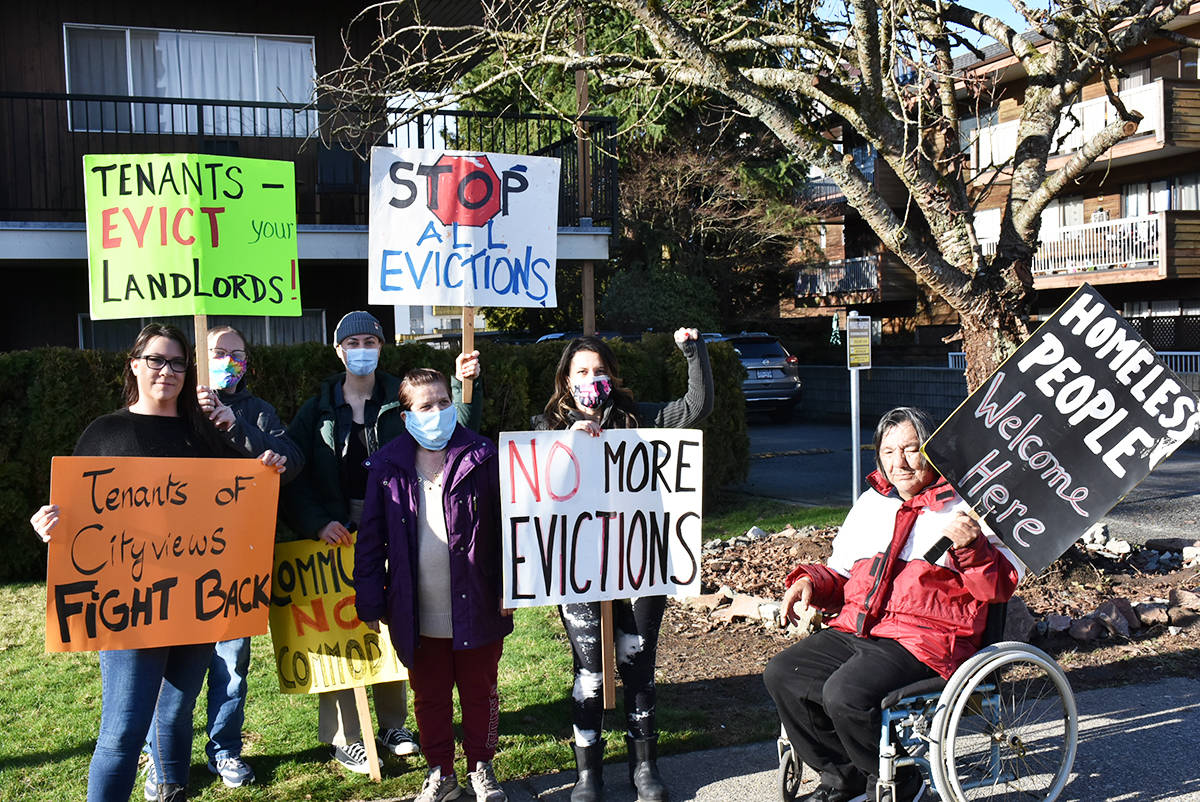 Ralliers gather in front of the Cityviews Village apartment building in Maple Ridge to protest attempts to evict low-income tenants by the building owner. (Ronan O'Doherty - The News)