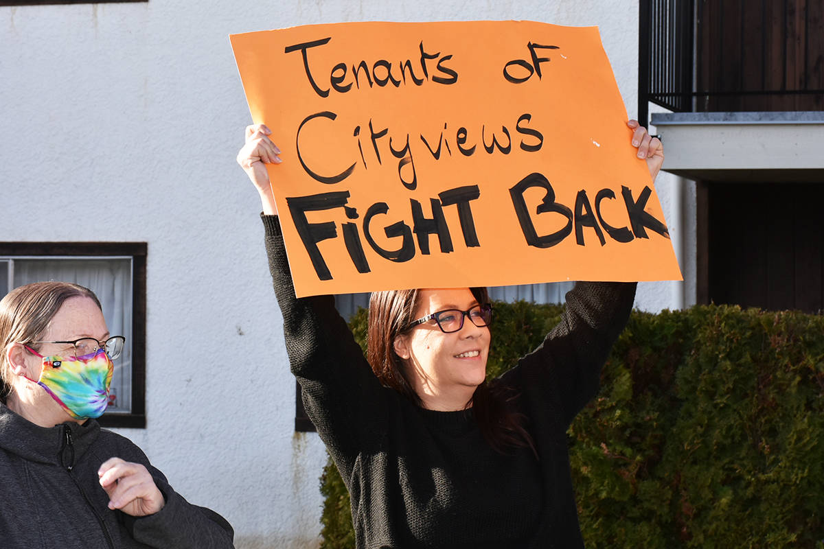 Cityviews Village tenant, Heather Bigcharles (holding sign), was one of a handful of speakers protesting the building owners' practices. (Ronan O'Doherty/ The News)