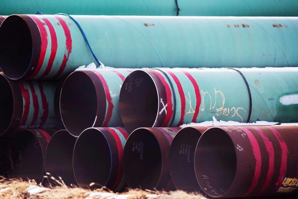 In this Dec. 18, 2020 photo, pipes to be used for the Keystone XL pipeline are stored in a field near Dorchester, Neb. THE CANADIAN PRESS/AP-Chris Machian /Omaha World-Herald via AP