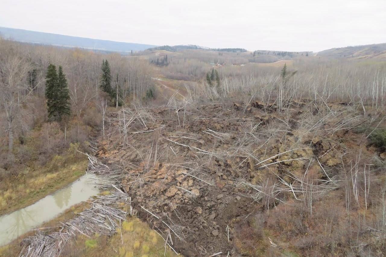 A slow moving landslide is seen inching down a hillside in northern British Columbia, prompting the evacuation of nearby Old Fort, B.C., in an undated handout photo. Residents of a tiny community in northern British Columbia are suing the local and provincial governments over two slow-moving landslides that they say caused their property values to plummet. THE CANADIAN PRESS/HO-B.C. Ministry of Forests and Lands, Marten Geertsema, *MANDATORY CREDIT*