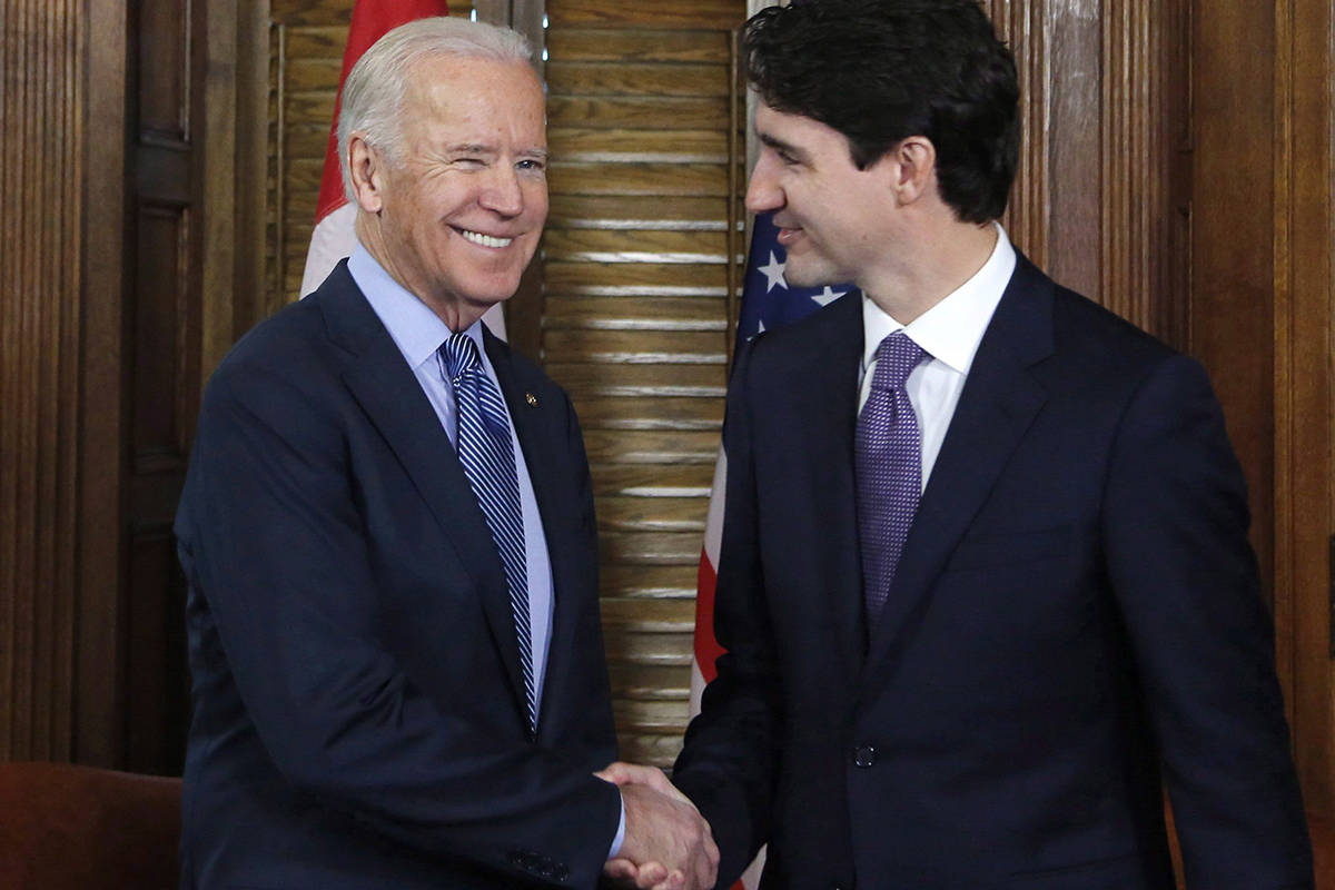 FILE – Prime Minister Justin Trudeau shakes hands with US Vice-President Joe Biden on Parliament Hill in Ottawa on Friday, December 9, 2016. THE CANADIAN PRESS/Patrick Doyle