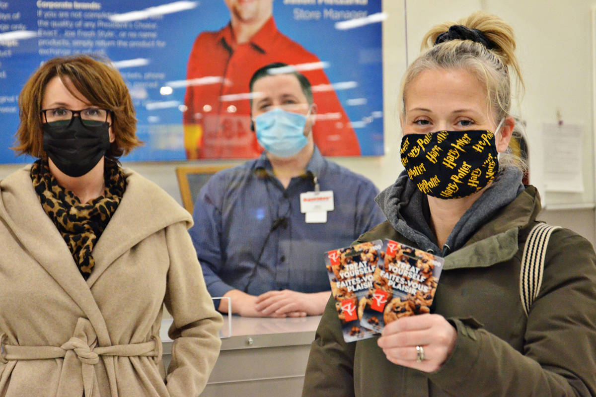 Langley Advance Times publisher Lisa Farquharson and Real Canadian Superstore Langley manager Jason Pietzarka presented Kristi Kocherkewych with her $200 prize in the third annual Win Everything You Didn't Get for Christmas Contest. (Heather Colpitts/Langley Advance Times)