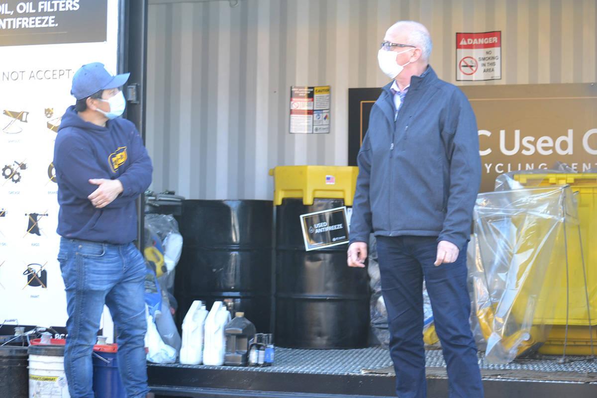 Langley MP Tako van Popta visited Aldergrove's Return-It Depot to commend owner Sung Kim on the oil collection project. (Ryan Uytdewilligen/Aldergrove Star)
