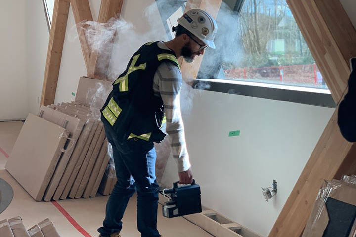 A worker completes an air tightness test at the Clayton Community Centre. Because of a budget shortfall, the City won't be opening the centre until 2021. (Photo courtesy of HCMA Architecture + Design)