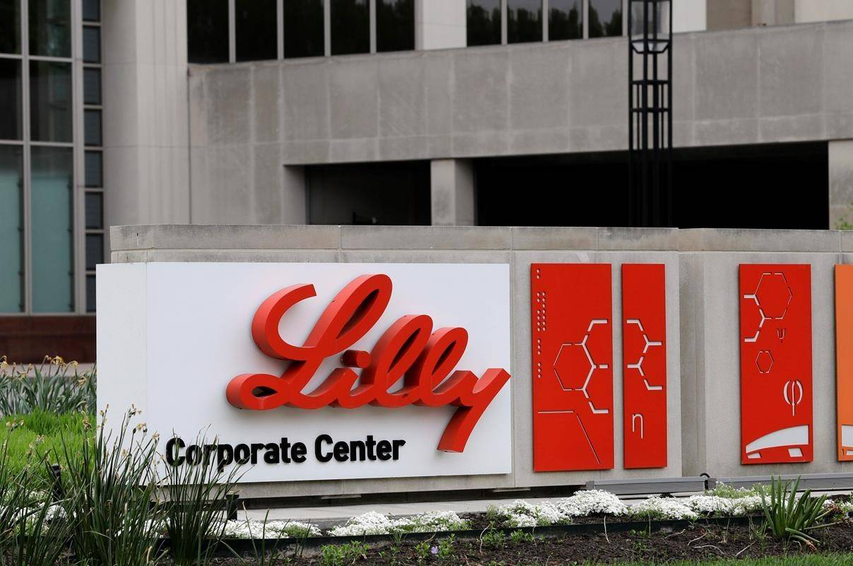 FILE - This April 26, 2017 file photo shows the Eli Lilly & Co. corporate headquarters in Indianapolis. Drugmaker Eli Lilly said Thursday, Jan. 21, 2021, its COVID-19 antibody drug can prevent illness among residents and staff of nursing homes and other long-term care locations. It's the first major study to show that it may prevent disease. The drugmaker said participants who got the drug had up to a 57% lower risk of getting COVID-19. (AP Photo/Darron Cummings, File)