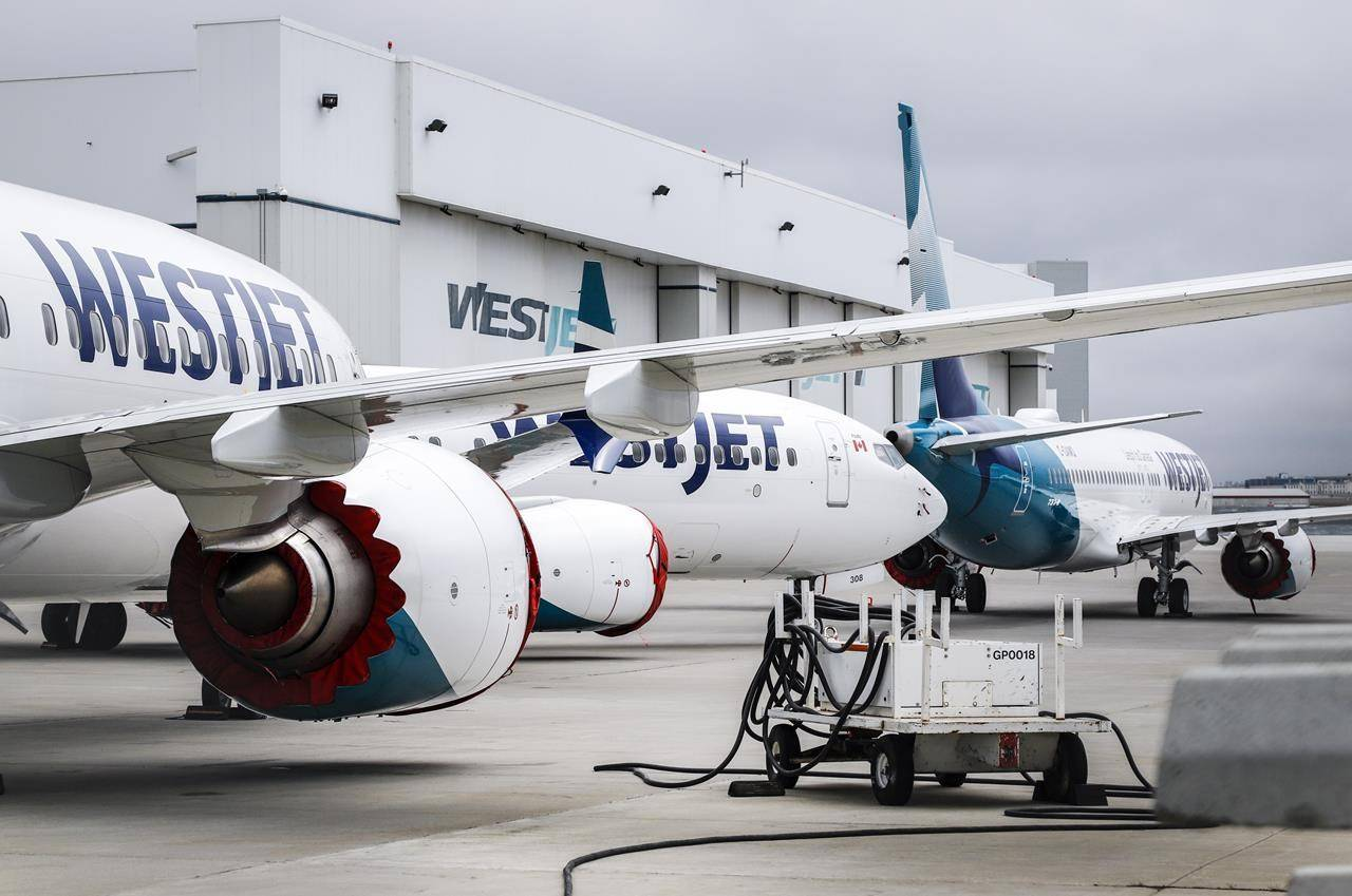 Grounded WestJet Boeing 737 Max aircraft are shown at the airline's facilities in Calgary, Alta., Tuesday, May 7, 2019. WestJet will operate the first commercial Boeing 737 Max flight in Canada today since the aircraft was grounded in 2019 following two deadly crashes. THE CANADIAN PRESS/Jeff McIntosh