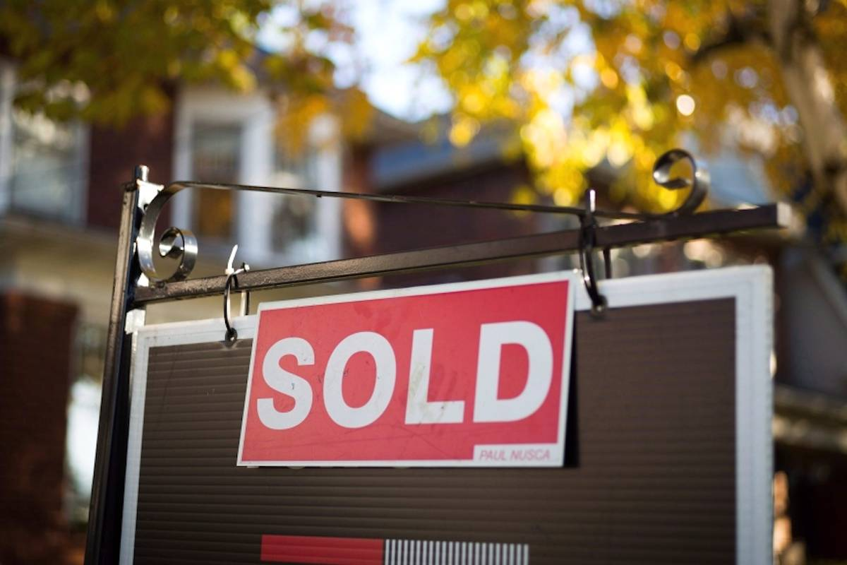 A real estate sold sign hangs in front of a Canadian property Friday, Nov. 4, 2016. THE CANADIAN PRESS/Graeme Roy