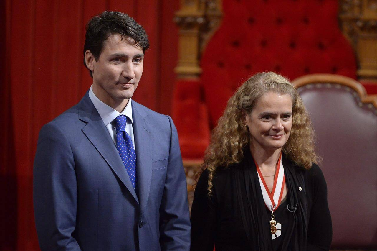 Canada's 29th Governor General Julie Payette looks on alongside Prime Minister Justin Trudeau in the Senate chamber during her installation ceremony, in Ottawa on Monday, October 2, 2017. THE CANADIAN PRESS/Adrian Wyld