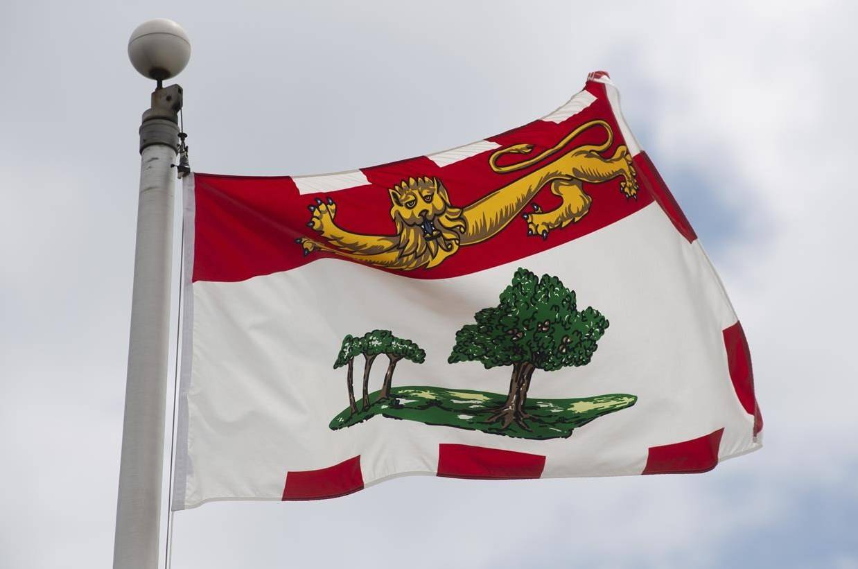 "Prince Edward Island's provincial flag flies on a flag pole in Ottawa, Friday July 3, 2020. A lozenge plant in Prince Edward Island has laid off 30 workers, citing an ""almost non-existent"" cold and cough season amid COVID-19 restrictions. THE CANADIAN PRESS/Adrian Wyld"