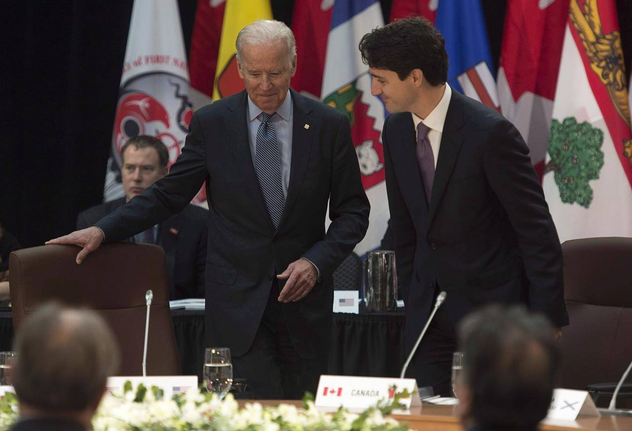 Joe Biden, then the U.S. vice-president, and Prime Minister Justin Trudeau take their seats at the start of the First Ministers and National Indigenous Leaders meeting in Ottawa, Friday, Dec. 9, 2016. THE CANADIAN PRESS/Adrian Wyld