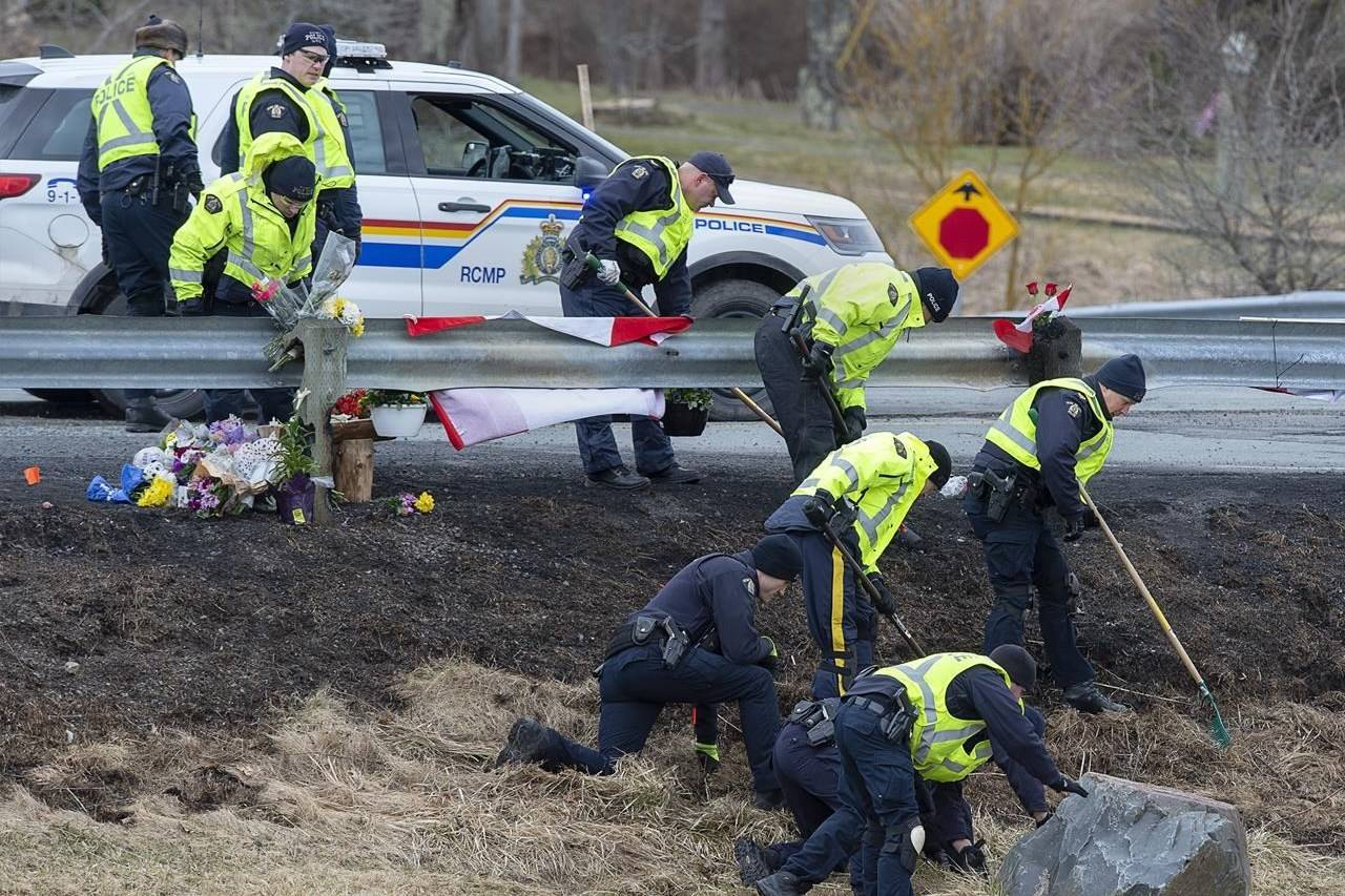 RCMP investigators search for evidence at the location where Const. Heidi Stevenson was killed along the highway in Shubenacadie, N.S. on Thursday, April 23, 2020. The public inquiry into the April mass shooting in Nova Scotia has announced the hiring of six experts who will help set a course for the investigation.THE CANADIAN PRESS/Andrew Vaughan