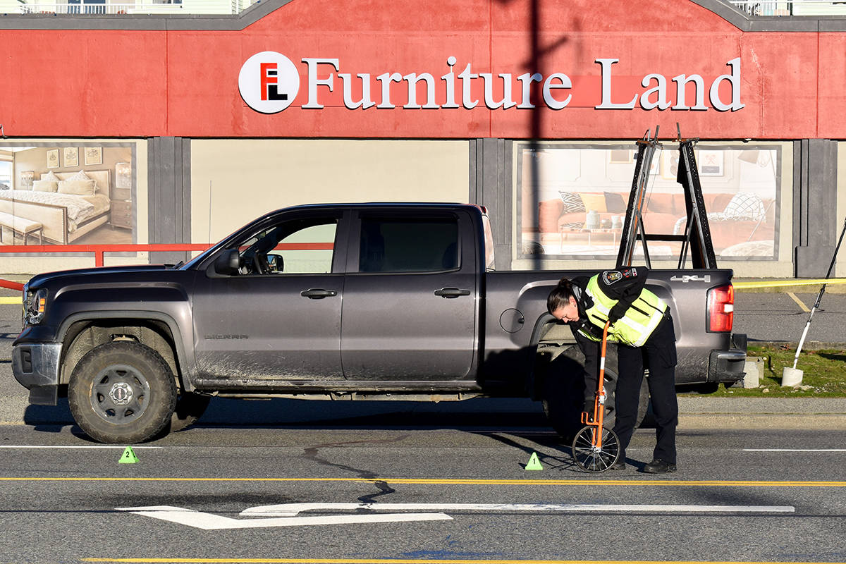 Abbotsford Police officers investigate the scene after a pedestrian was struck and killed on Friday morning. (Ben Lypka/Abbotsford News)