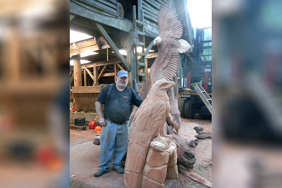 Pete Ryan poses with an eagle carving, which was featured on Saw Dogs. (Hope Standard File)
