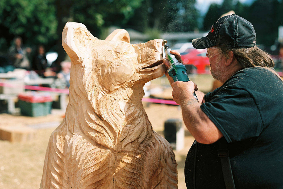 Pete Ryan, carving a bear (Black Press)