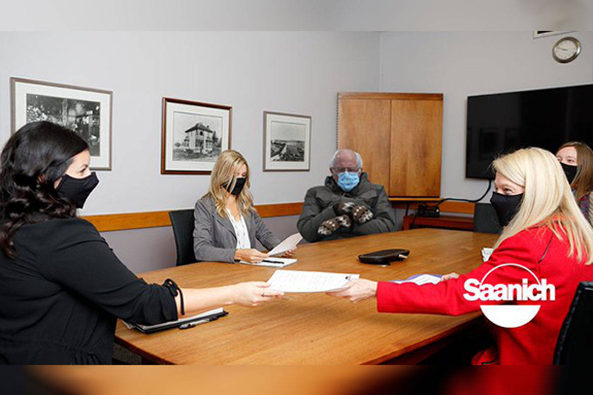 The District of Saanich's communications team decided to take part in a viral trend on Thursday and photoshopped U.S. Senator Bernie Sanders into a staff meeting photo. (District of Saanich/Twitter)