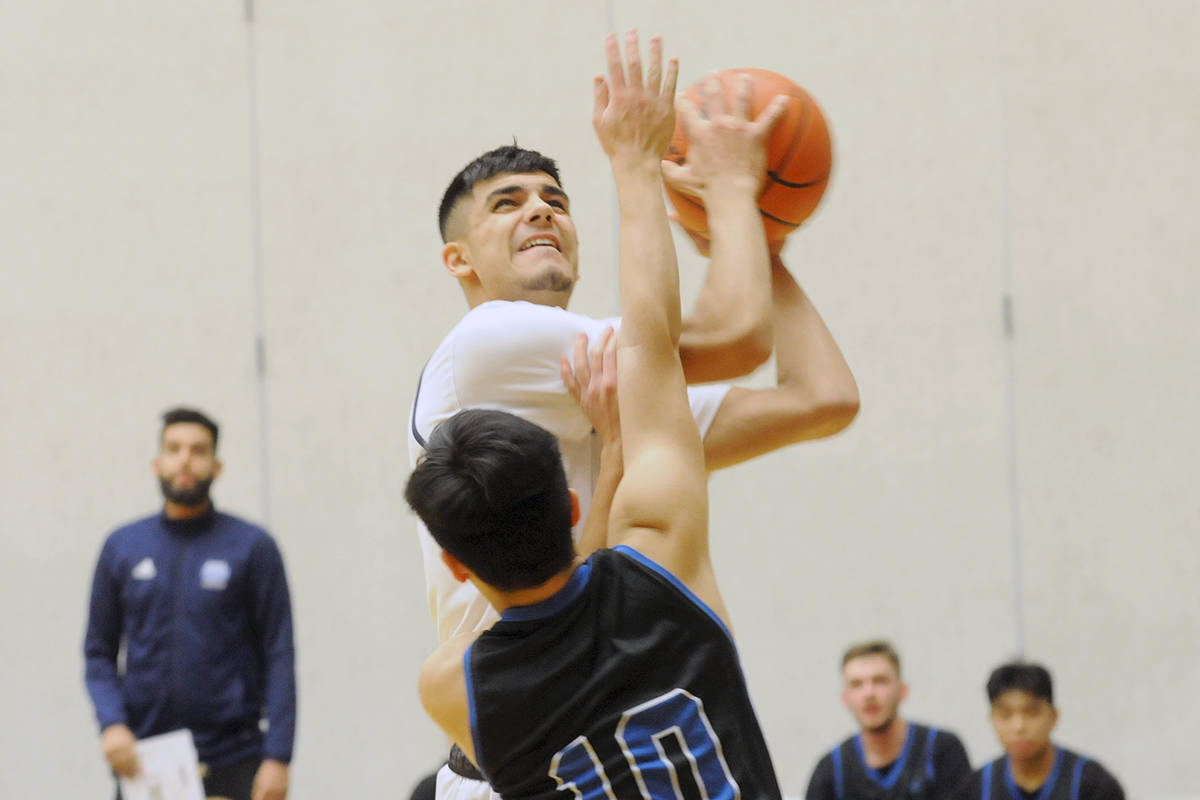 A Fleetwood Park Dragons player goes for a shot during the opening game of the Tsumura Basketball Invitational (TBI) at the Langley Events Centre in 2019. Founder Howard Tsumura is hoping to hold a 2021 version of the tournament (Langley Advance Times file)